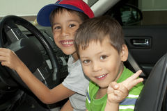 Children driving a car Royalty Free Stock Photography