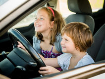 Children driving car Royalty Free Stock Images