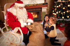 Children eagerly waiting gift from Santa Claus Royalty Free Stock Photo