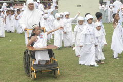 CHILDREN EARLY LEARNING DISABLED CHILDREN AND WORSHIP HAJJ. Participants include students with disabilities early age to use a wheelchair or walking in Royalty Free Stock Photography