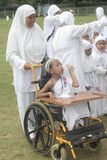 CHILDREN EARLY LEARNING DISABLED CHILDREN AND WORSHIP HAJJ. Participants include students with disabilities early age to use a wheelchair or walking in Stock Image