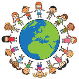 Children and earth. Children holding hand around the earth Stock Photo