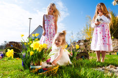 Children on Easter egg hunt with bunny royalty free stock photography