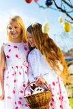 Children on Easter egg hunt with bunny Stock Image