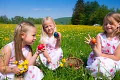 Children on Easter egg hunt with eggs Stock Photo