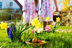 Children on Easter egg hunt with eggs Royalty Free Stock Images
