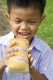Children eat bread Royalty Free Stock Images
