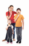 Children eat candies Royalty Free Stock Image