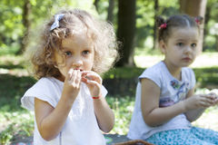 Children eat outdoors Royalty Free Stock Image