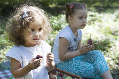 Children eat outdoors Stock Photography