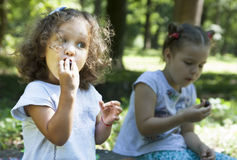 Children eat outdoors Stock Image