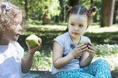Children eat outdoors Stock Photos