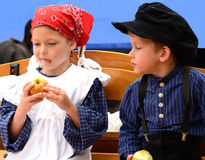 Children eating apple on the cheese market royalty free stock images