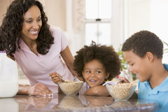 Children Eating Breakfast Stock Images