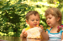 Children eating cookies. Boy and girl eating cookies Stock Photography