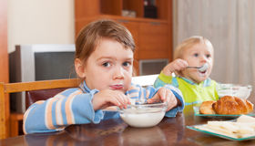 Children eating dairy breakfast Royalty Free Stock Images