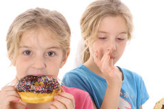 Children eating a doughnut Stock Image