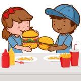 Children eating hamburgers Stock Photos