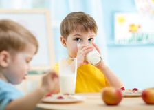 Children eating healthy food at home Royalty Free Stock Image