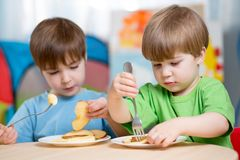 Children eating healthy food at home Stock Photo