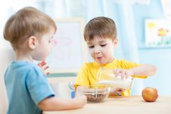 Children eating healthy food at home Stock Images