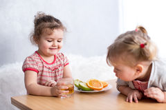 Children eating healthy food in kitchen Royalty Free Stock Images