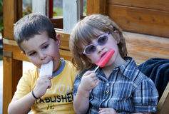 Children eating ice cream Stock Images