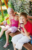 Children eating ice cream in park Stock Photography