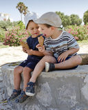 Children eating ice cream Stock Photos
