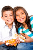 Children eating pizza Stock Images