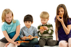 Children Eating Pizza Stock Photography