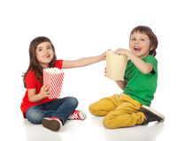 Children eating popcorn Stock Photos