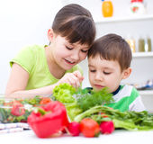 Children eating salad Royalty Free Stock Photo