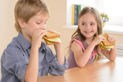 Children eating sandwiches. Stock Photos