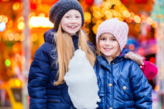 Children eating sweet candy on Christmas market Royalty Free Stock Photo