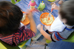 Children eating Stock Images