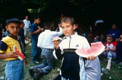 Children eating watermelon, Kosovo. Stock Image