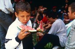 Children eating watermelon, Kosovo. Royalty Free Stock Photo