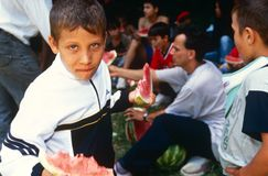 Children eating watermelon, Kosovo. Royalty Free Stock Images