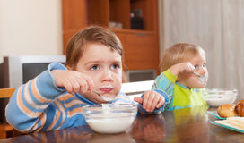 Children eating  yogurt Stock Image