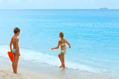 Children on Egremni beach (Lefkada, Greece) Royalty Free Stock Image