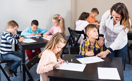 Children of elementary age having class of art stock photos