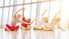 Children in elementary school do sport exercise. Together royalty free stock image