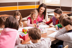 Children in elementary school on the workshop with their teacher Stock Images