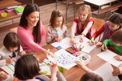 Children in elementary school on the workshop with their teacher Royalty Free Stock Images