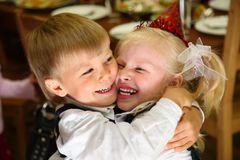 Children embrace on holiday Stock Image