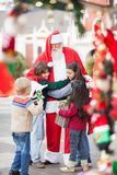 Children Embracing Santa Claus Royalty Free Stock Images