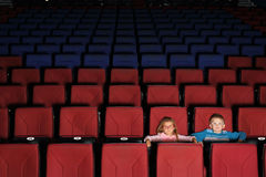 Children in an empty cinema hall stock image