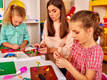 Children are engaged in modeling clay. stock photo