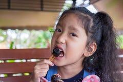 children enjoy eating chocolate ball Royalty Free Stock Image